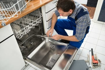 A picture of one of our dishwasher techs fixing a dishwasher
